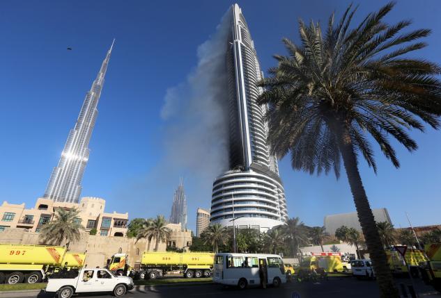 Plumes of smoke rise from the 63-storey Address Downtown Dubai hotel and residential block near the Burj Khalifa in Dubai